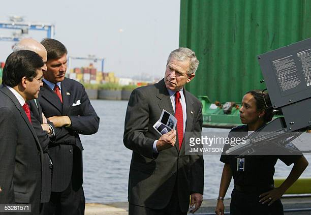 US President George W Bush shows images from a cargo xray machine to Maryland Governor Bob Ehrlich Homeland Security Secretary Michael Chertoff and...