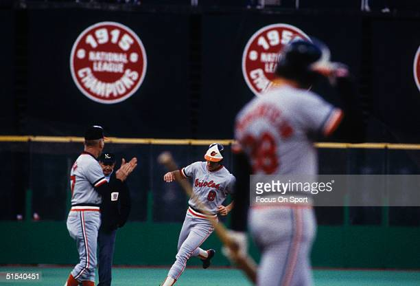 Baltimore's Cal Ripken Jr is cheered on by his father Cal Ripken Sr as he runs the bases against the Philadelphia Phillies during the World Series at...