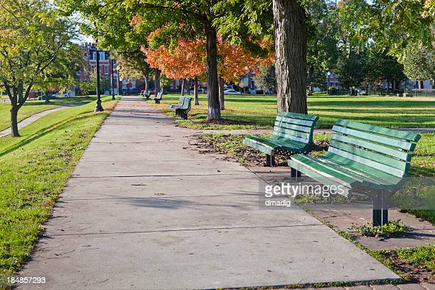 baltimore's federal hill park - benches lining the sidewalk - baltimore stock photos and pictures