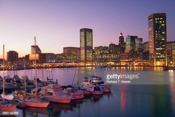 baltimore's inner harbor in the evening - baltimore maryland stock pictures, royalty-free photos & images