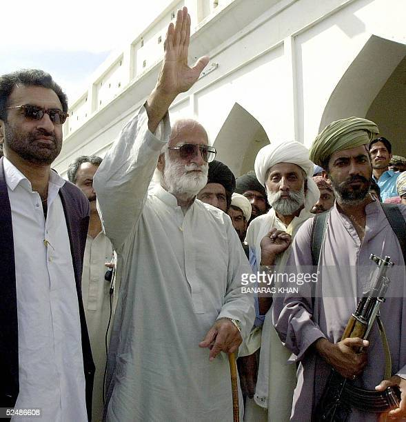 Baluch tribal chieftain Nawab Akbar Bugti waves to a crowd while surrounded by his bodyguards in Dera Bugti some 650 kilometers southwest from...