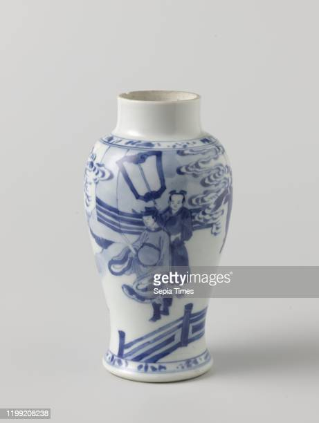 Baluster covered jar with three figures in a fenced garden Balustershaped porcelain covered pot painted underglaze blue On the wall a scene of a...