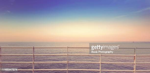 balustrade with view of horizon over the sea at sunset - 柵 ストックフォトと画像