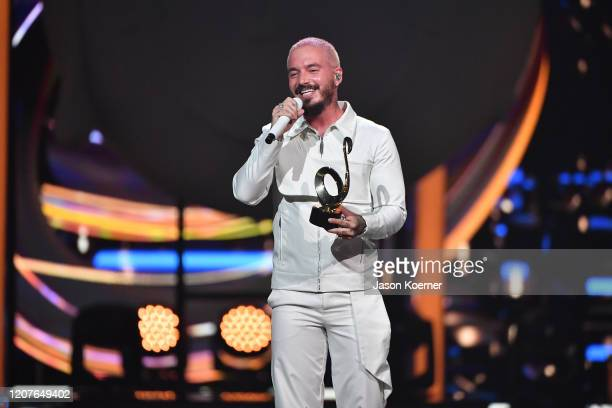 Balvin accepts an award on stage during Univision's Premio Lo Nuestro 2020 at AmericanAirlines Arena on February 20 2020 in Miami Florida