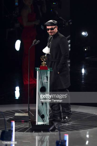Balvin accepts the Best Urban Music Album award for 'Colores' onstage during The 21st Annual Latin GRAMMY Awards at American Airlines Arena on...