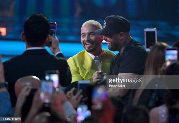 Balvin and Nicky Jam react after winning the Airplay Song of the Year award for X during the 2019 Billboard Latin Music Awards at the Mandalay Bay...