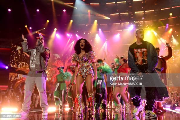 J Balvin Cardi B and Bad Bunny perform onstage at the 2018 American Music Awards at Microsoft Theater on October 9 2018 in Los Angeles California