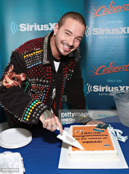 Balvin is presented a cake at the SiriusXM Studios on May 16 2018 in New York City