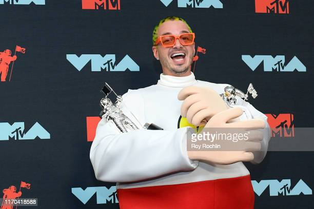 Balvin poses with awards in the Press Room during the 2019 MTV Video Music Awards at Prudential Center on August 26 2019 in Newark New Jersey