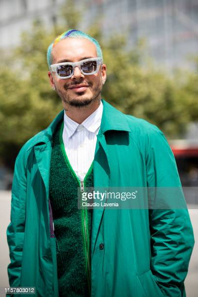 Balvin wearing a green trench coat and white shirt is seen outside Kenzo fashion show on Day 6 during the Paris Fashion Week Spring/Summer 2020 on...