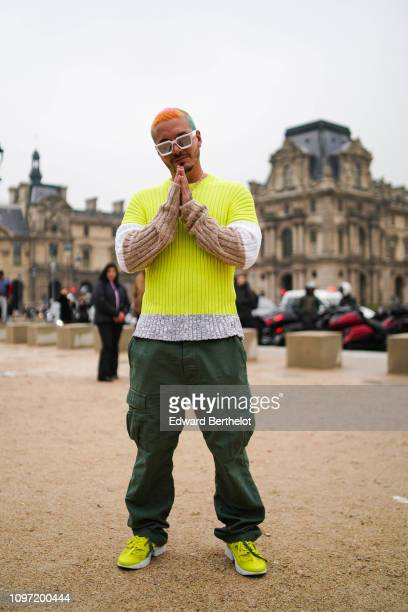 Balvin wears a yellow top green pants outside Kenzo during Paris Fashion Week Menswear F/W 20192020 on January 20 2019 in Paris France