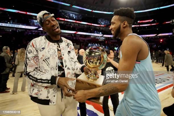 Bam Adebayo and Derrick Jones Jr #5 of the Miami Heat celebrate after Jones Jr won the 2020 NBA AllStar ATT Slam Dunk Contest during State Farm...