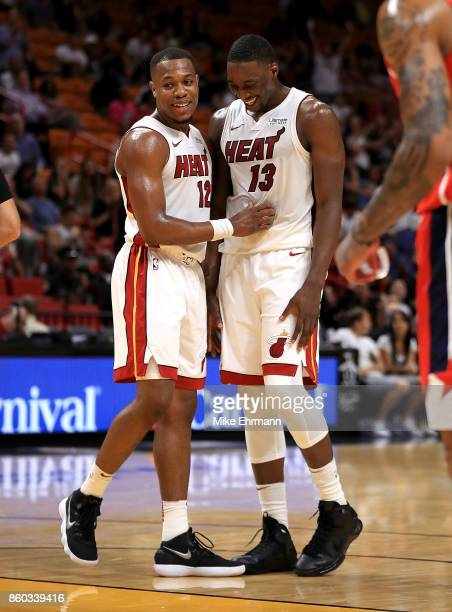 Bam Adebayo and Matt Williams of the Miami Heat reacts to a dunk during a preseason game against the Washington Wizards at American Airlines Arena on...