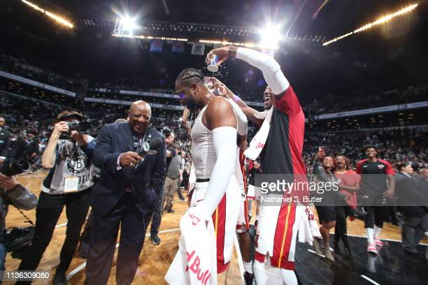 Bam Adebayo celebrates with Dwyane Wade of the Miami Heat as he speaks with the media after the game against the Brooklyn Nets on April 10 2019 at...