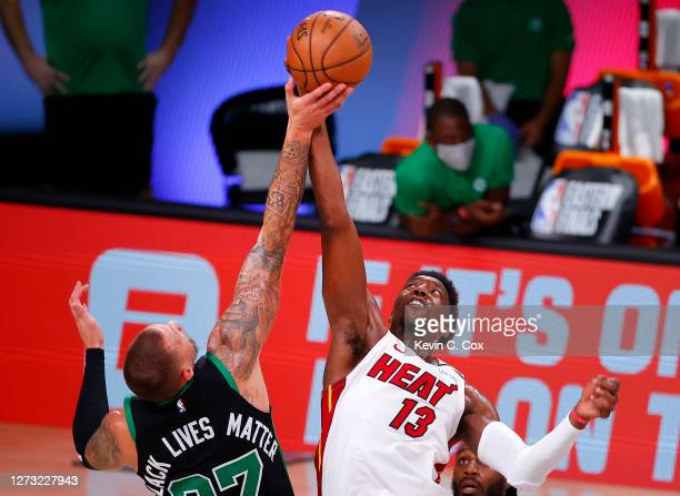 Bam Adebayo of the Miami Heat and Daniel Theis of the Boston Celtics compete for a jump ball during the fourth quarter in Game Two of the Eastern...