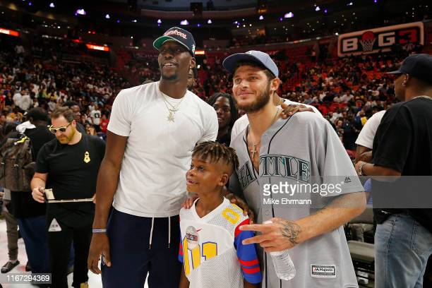Bam Adebayo of the Miami Heat and Tyler Johnson of the Phoenix Suns take a photo with a young fan during week eight of the BIG3 three on three...