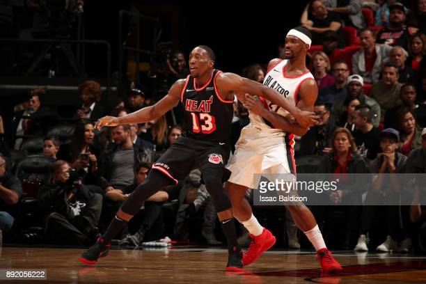 Bam Adebayo of the Miami Heat battles for position against Noah Vonleh of the Portland Trail Blazers on December 13 2017 at American Airlines Arena...