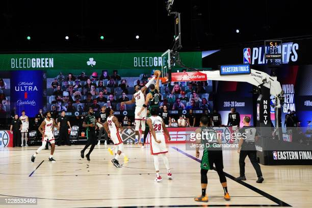 Bam Adebayo of the Miami Heat blocks a dunk attempt in the game against Jayson Tatum of the Boston Celtics in Game one of the Eastern Conference...