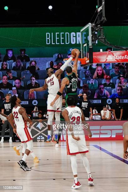 Bam Adebayo of the Miami Heat blocks a dunk attempt in the game against Jayson Tatum of the Boston Celtics during Game One of the Eastern Conference...