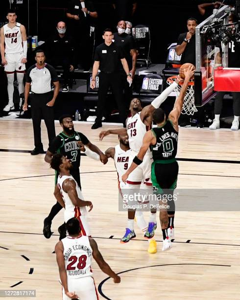 Bam Adebayo of the Miami Heat blocks a shot from Jayson Tatum of the Boston Celtics in the final seconds of overtime to defeat the Boston Celtics by...