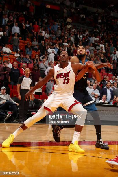 Bam Adebayo of the Miami Heat boxes out KarlAnthony Towns of the Minnesota Timberwolves during the game between the two teams at the American...
