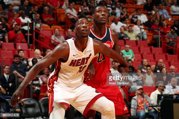Bam Adebayo of the Miami Heat boxes out the Washington Wizards during a preseason game at the American Airlines Arena on October 11 2017 in Miami...