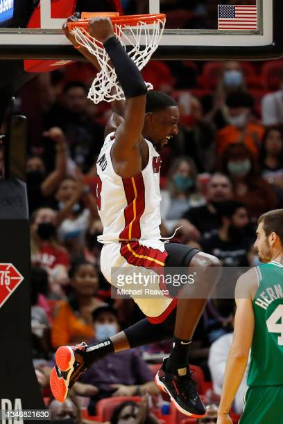Bam Adebayo of the Miami Heat celebrates a dunk against the Boston Celtics during the second half of a preseason game at FTX Arena on October 15,...