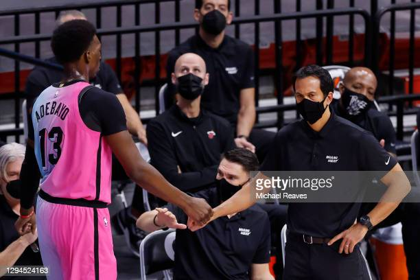 Bam Adebayo of the Miami Heat celebrates a play with head coach Erik Spoelstra during the fourth quarter against the Oklahoma City Thunder at...