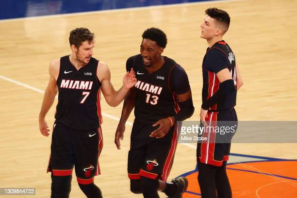 Bam Adebayo of the Miami Heat celebrates his basket with Goran Dragic and Tyler Herro against the New York Knicks at Madison Square Garden on March...