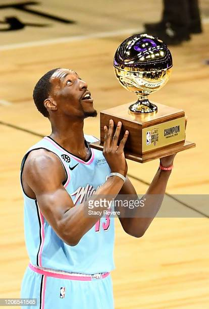 Bam Adebayo of the Miami Heat celebrates with the trophy after winning the 2020 NBA AllStar Taco Bell Skills Challenge during State Farm AllStar...