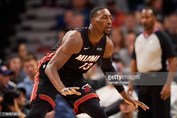 Bam Adebayo of the Miami Heat defends against the Minnesota Timberwolves during the home opener at Target Center on October 27 2019 in Minneapolis...