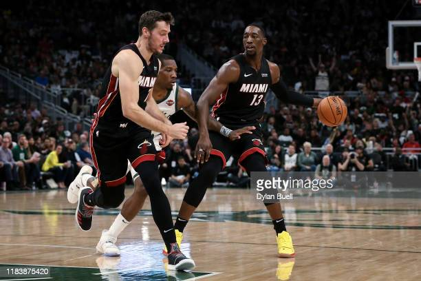 Bam Adebayo of the Miami Heat dribbles the ball while being guarded by Eric Bledsoe of the Milwaukee Bucks in the third quarter at the Fiserv Forum...