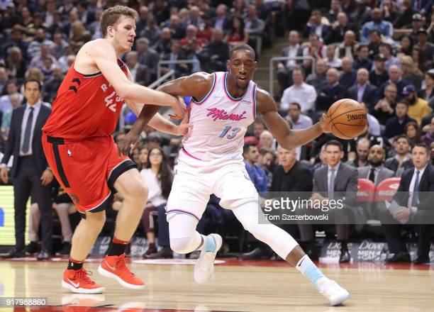 Bam Adebayo of the Miami Heat drives against Jakob Poeltl of the Toronto Raptors at Air Canada Centre on February 13 2018 in Toronto Canada NOTE TO...