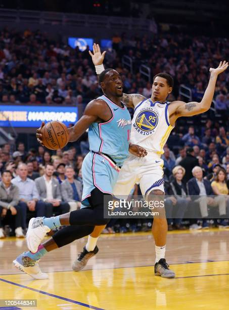 Bam Adebayo of the Miami Heat drives to the basket against Juan ToscanoAnderson of the Golden State Warriors in the first half at Chase Center on...