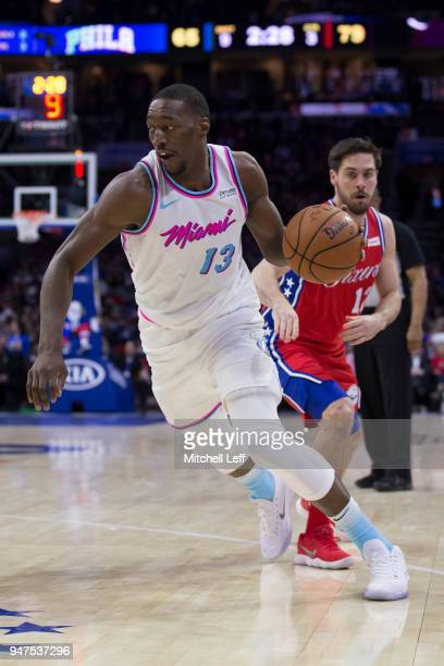 Bam Adebayo of the Miami Heat drives to the basket past TJ McConnell of the Philadelphia 76ers at the Wells Fargo Center on February 14 2018 in...
