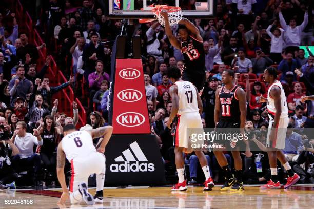 Bam Adebayo of the Miami Heat dunks against the Portland Trail Blazers in the fourth quarter at American Airlines Arena on December 13 2017 in Miami...