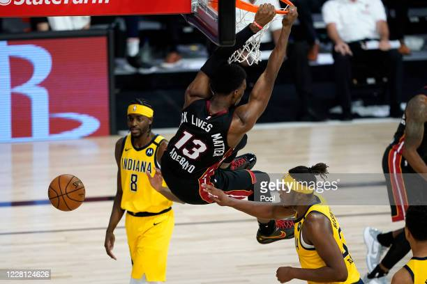 Bam Adebayo of the Miami Heat dunks as Justin Holiday and Myles Turner of the Indiana Pacers watch in the second half in Game Two during the first...