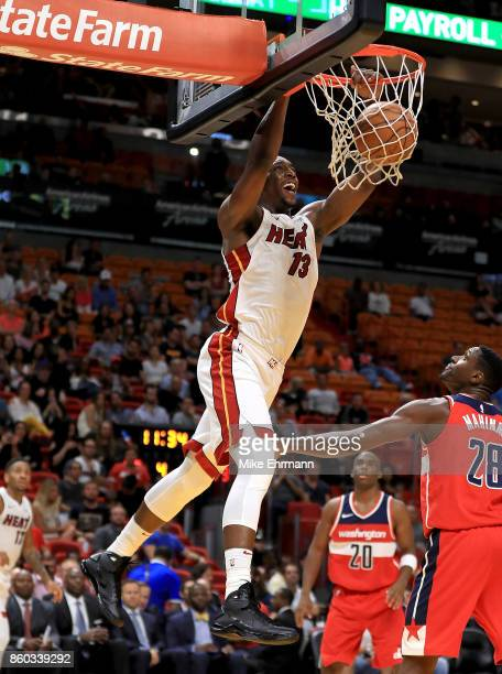 Bam Adebayo of the Miami Heat dunks during a preseason game against the Washington Wizards at American Airlines Arena on October 11 2017 in Miami...