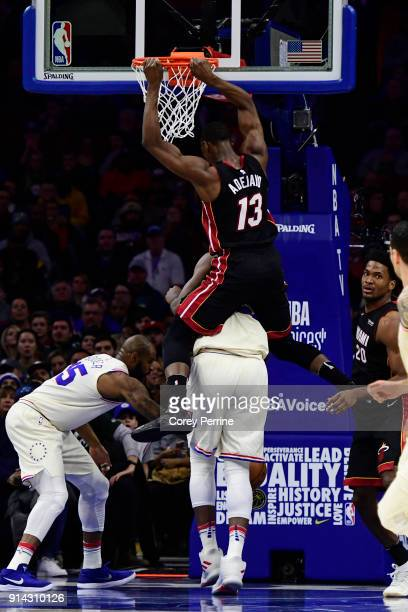 Bam Adebayo of the Miami Heat dunks on Joel Embiid of the Philadelphia 76ers during the first quarter at the Wells Fargo Center on February 2 2018 in...