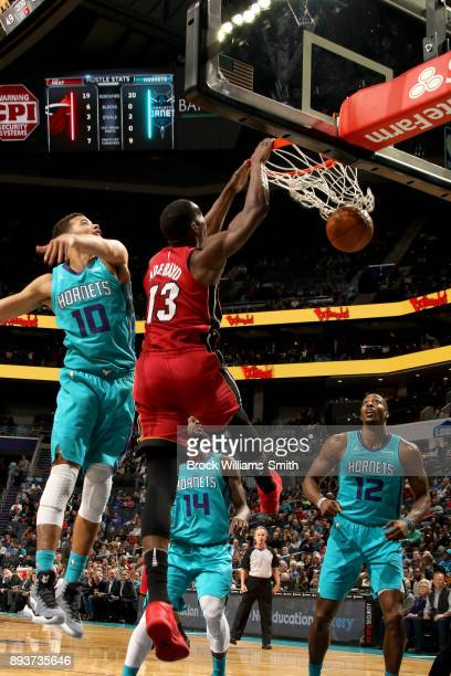 Bam Adebayo of the Miami Heat dunks the ball against the Charlotte Hornets on December 15 2017 at Spectrum Center in Charlotte North Carolina NOTE TO...