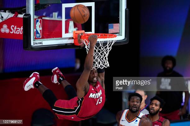 Bam Adebayo of the Miami Heat dunks the ball past Deandre Ayton of the Phoenix Suns during the second half of an NBA basketball game at Visa Athletic...