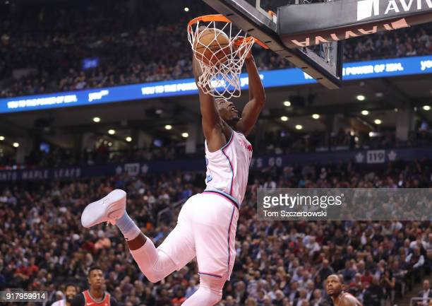 Bam Adebayo of the Miami Heat finishes an alleyoop as he dunks the ball against the Toronto Raptors at Air Canada Centre on February 13 2018 in...
