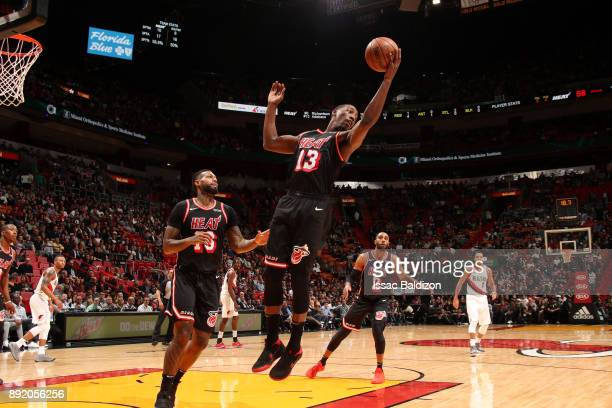 Bam Adebayo of the Miami Heat grabs the rebound against the Portland Trail Blazers on December 13 2017 at American Airlines Arena in Miami Florida...