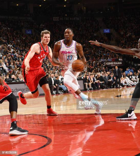 Bam Adebayo of the Miami Heat handles the ball against Jakob Poeltl of the Toronto Raptors on February 13 2018 at the Air Canada Centre in Toronto...