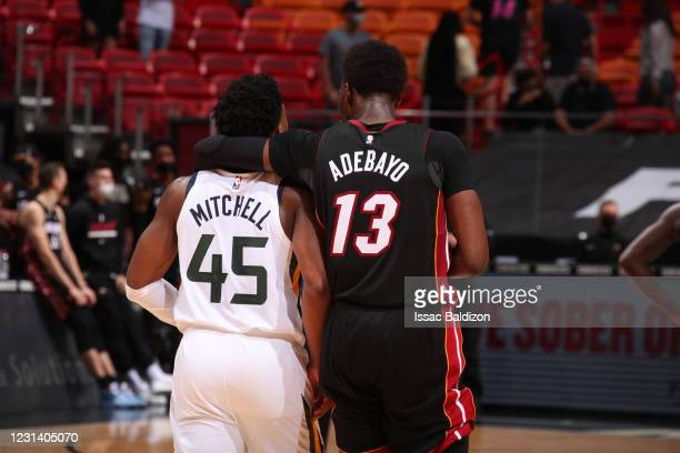 Bam Adebayo of the Miami Heat hugs Donovan Mitchell of the Utah Jazz during the game on February 26, 2021 at American Airlines Arena in Miami,...