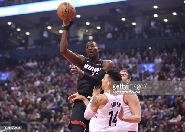 Bam Adebayo of the Miami Heat is called for an offensive foul as he goes to the basket in the first quarter against Danny Green of the Toronto...