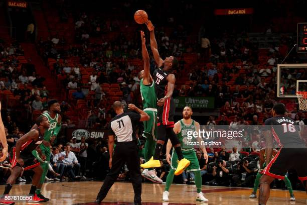 Bam Adebayo of the Miami Heat jumps for the ball to start the game against the Boston Celtics at the American Airlines Arena on October 28 2017 in...