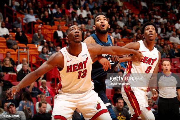 Bam Adebayo of the Miami Heat KarlAnthony Towns of the Minnesota Timberwolves and Josh Richardson of the Miami Heat react during the game between the...