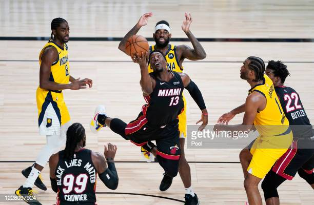 Bam Adebayo of the Miami Heat makes an off-balanced shot against Justin Holiday, JaKarr Sampson and T.J. Warren of the Indiana Pacers during the...
