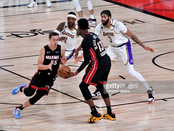 Bam Adebayo of the Miami Heat passes the ball to Duncan Robinson of the Miami Heat against the Los Angeles Lakers during Game Six of the NBA Finals...